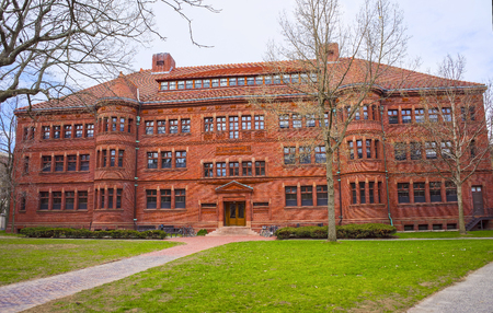harvard: Cambridge, USA - April 29, 2015: East facade of Sever Hall in Harvard Yard in Harvard University, Massachusetts, MA, USA. It is used as the library, lecture hall and classroom for different courses.
