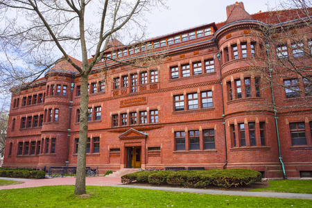 sever: Cambridge, USA - April 29, 2015: East facade of Sever Hall in Harvard Yard at Harvard University, Massachusetts, MA, USA. It is used as the library, lecture hall and classroom for different courses Editorial
