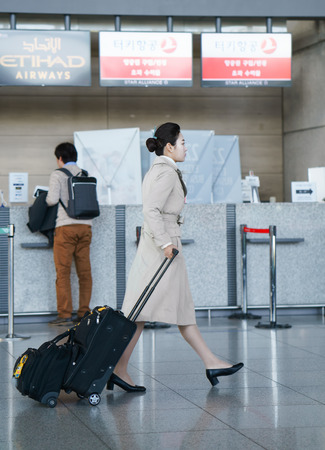 incheon: Incheon, South Korea - February 15, 2016: Asian Korean female air flight attendant at the Incheon international airport. It is one of the largest and busiest world airports