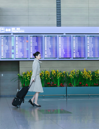 incheon: Incheon, South Korea - February 15, 2016: Asian Korean female flight attendant at the International airport of Incheon. It is one of the largest and busiest world airports Editorial