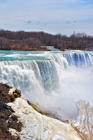 american falls: Niagara Falls viewed from the American side in spring. A view from Niagara State Park on American Falls and Bridal Veil Falls. Stock Photo