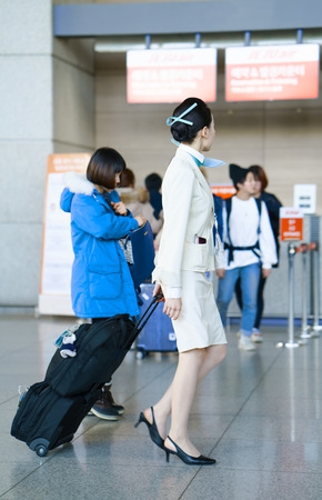 incheon: Incheon, South Korea - February 15, 2016: Asian female air flight attendant at Incheon International airport. It is one of the largest and busiest world airports. Editorial