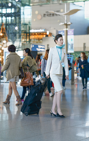 incheon: Incheon, South Korea - February 15, 2016: Asian Korean female air flight stewardess in the Incheon international airport. It is one of the largest and busiest world airports