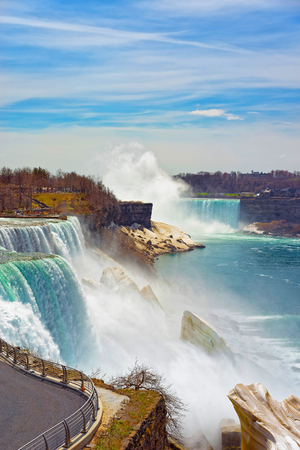 american falls: Niagara Falls viewed from the American side. A view from Niagara State Park on American Falls, Bridal Veil Falls, Goat Island and Horseshoe Falls on the background.