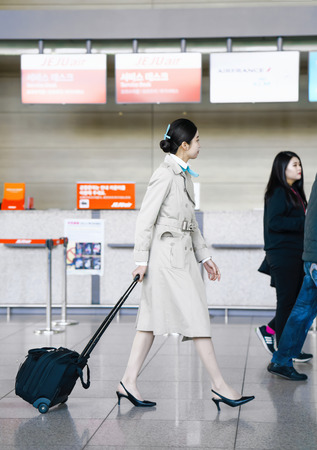 Incheon, South Korea - February 15, 2016: Asian Korean female air flight hostess in Incheon International airport. It is one of the largest and busiest world airports.