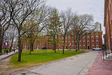 dormitories: Cambridge, USA - April 29, 2015: Hollis Hall and Stoughton Hall at Harvard Yard of Harvard University, Massachusetts, MA. They serve as dormitories for Harvard students. Tourists in the street Editorial