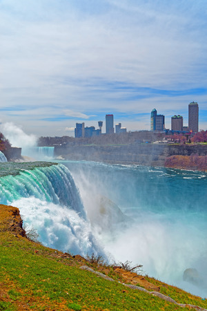 american falls: Niagara Falls from the American side and Skyscrapers in Canada. A view on American Falls, Bridal Veil Falls, Goat Island, Horseshoe falls and Canada Skyscrapers on the background.