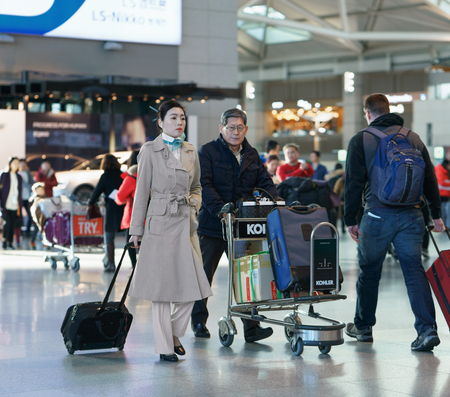 incheon: Incheon, South Korea - February 15, 2016: Asian Korean female flight attendant at the Incheon international airport. It is one of the largest and busiest world airports Editorial