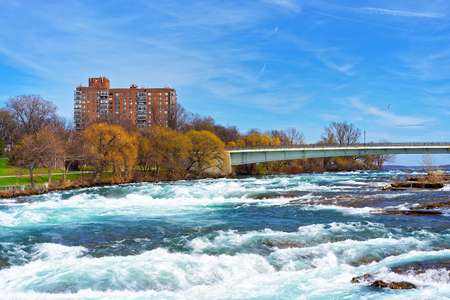 niagara river: Bridge above Niagara and Thresholds of the Niagara River from the American part near Niagara Falls. Niagara Falls are the waterfalls between the United States of America and Canada.