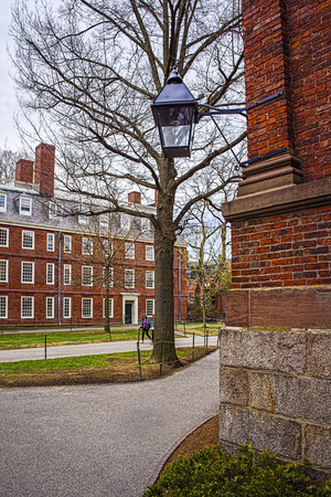 harvard: Cambridge, USA - April 29, 2015: Dormitory building at Harvard Yard of Harvard University in Cambridge, Massachusetts, MA, USA. Tourists in the street Editorial