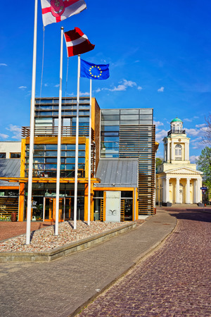 nikolay: Ventspils, Latvia - May 8, 2016: Ventspils Library and Lutheran Church of St Nicholas in the City Center of Ventspils. It is a city in the Courland region of Latvia. Latvia is a Baltic country.