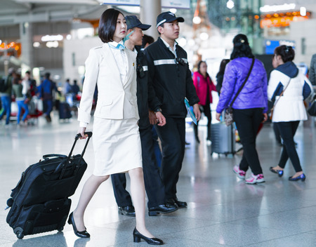 incheon: Incheon, South Korea - February 15, 2016: Asian Korean female air flight attendant in International airport of Incheon. It is one of the largest and busiest world airports.