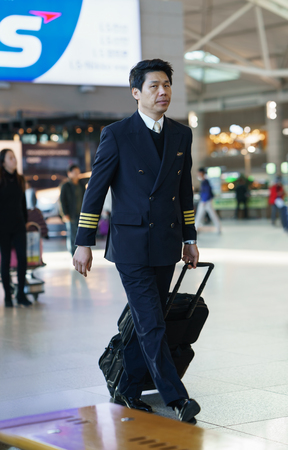 Incheon, South Korea - February 15, 2016: Asian Korean male flight attendant in the Incheon international airport. It is one of the largest and busiest world airports Publikacyjne