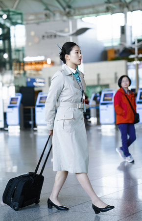 Incheon, South Korea - February 15, 2016: Asian Korean female air flight hostess at International airport of Incheon. It is one of the largest and busiest world airports.