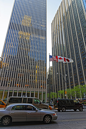 the americas: New York, USA - May 6, 2015: Street view on Avenue of the Americas and Exxon Building and Time-Life Building. Midtown Manhattan, New York, USA