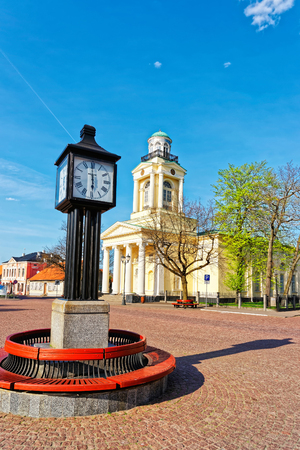 nikolay: Ventspils, Latvia - May 8, 2016: Clock and Lutheran Church of Saint Nicholas in Ventspils in the Town Hall Square. Ventspils is a city in the Courland region of Latvia. Latvia is a Baltic country.