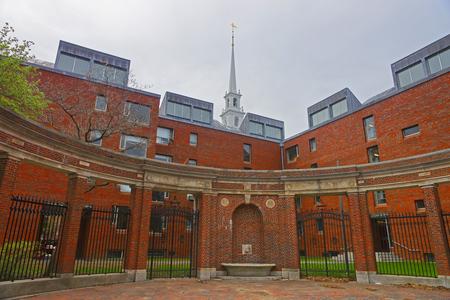 harvard university: Cambridge, USA - April 29, 2015: Fence at Harvard University building in Harvard Yard in Cambridge, Massachusetts, MA, USA. Memorial Church Steeple on the background.