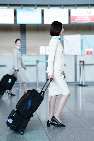 Incheon, South Korea - February 15, 2016: Asian Korean female air flight hostess in International airport of Incheon. It is one of the largest and busiest world airports. Editorial