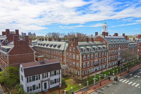 Aerial view on John F Kennedy Street in Harvard University Area in Cambridge, Massachusetts, the USA. Eliot House white belltower seen on the background. Tourists in the street Archivio Fotografico