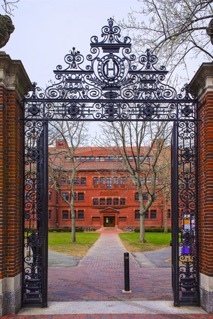sever: Entrance gate and East facade of Sever Hall in Harvard Yard in Harvard University of Cambridge, Massachusetts, MA, USA. It is used as the library, lecture hall and classroom for different courses.