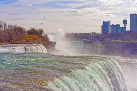 american falls: Niagara Falls from American side and Skyscrapers of Canadian side. A view on American Falls, Bridal Veil Falls, Goat Island, Horseshoe falls and Canada Skyscrapers on the background.