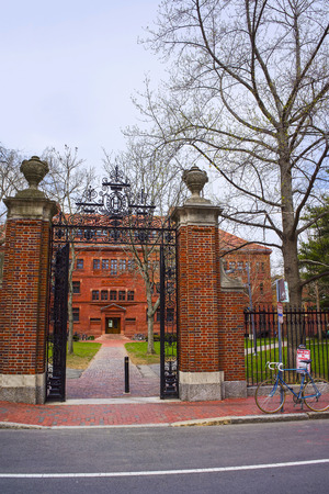 sever: Entrance gate and East facade of Sever Hall in Harvard Yard in Harvard University in Cambridge, Massachusetts, MA, USA. It is used as the library, lecture hall and classroom for different courses.