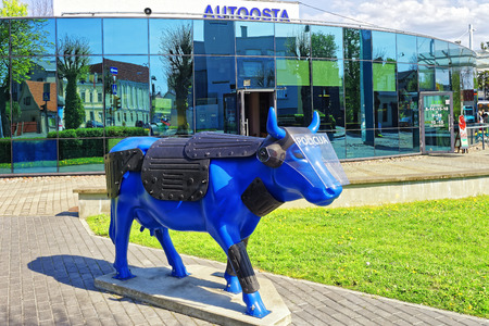baltic people: Ventspils, Latvia - May 8, 2016: Bus terminal and Blue Cow in Ventspils in Latvia. Ventspils is a town in Courland region of Latvia. Latvia is one of the Baltic countries. People in the terminal Editorial