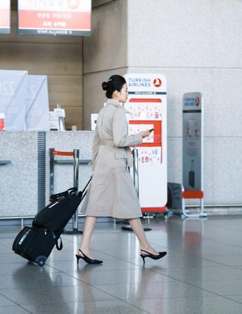 air hostess: Incheon, South Korea - February 15, 2016: Asian female air flight hostess in International airport of Incheon. It is one of the largest and busiest world airports. Editorial