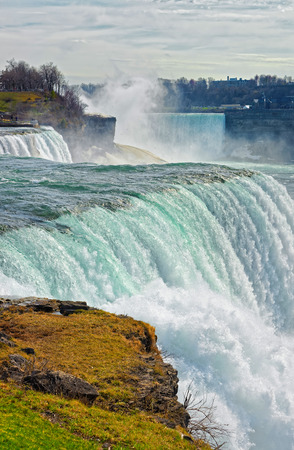 the edge of horseshoe falls: Niagara Falls viewed from American side. A view from Niagara State Park on American Falls, Bridal Veil Falls, Goat Island and Horseshoe Island on the background.