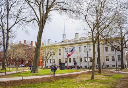 Cambridge, USA - April 29, 2015: University Hall and John Harvard Monument in the campus of Harvard University, Massachusetts, MA, the USA. It is well-known statue of Harvard University founder in America.