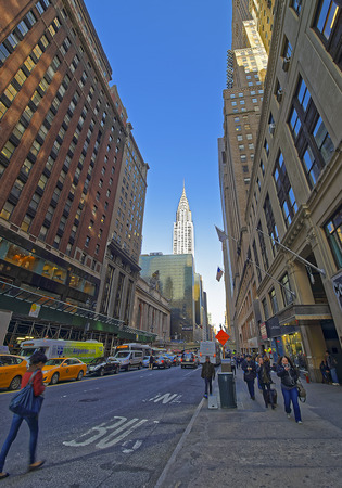 42nd: New York, USA - April 26, 2015: East 42nd Street and Madison Avenue and a view to Chrysler Building. In Midtown Manhattan, New York City, USA