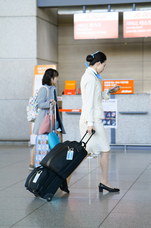 incheon: Incheon, South Korea - February 15, 2016: Asian female air flight hostess at Incheon International airport. It is one of the largest and busiest world airports. Editorial