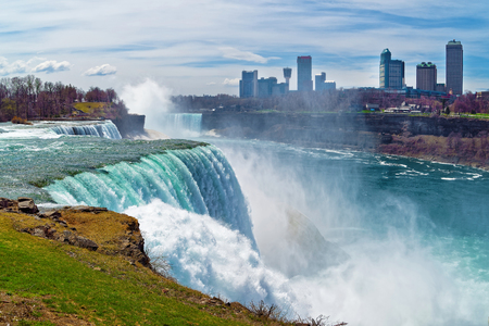 american falls: Niagara Falls from the American side and Skyscrapers in Canadian side. A view on American Falls, Bridal Veil Falls, Goat Island, Horseshoe falls and Canada Skyscrapers on the background.