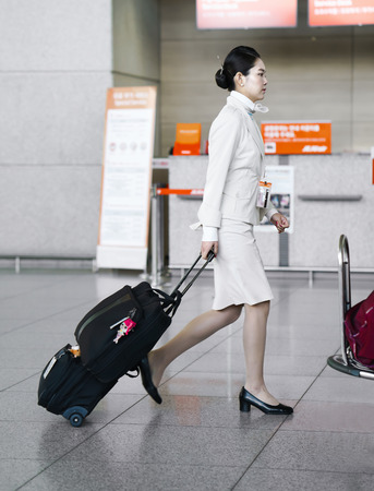 Incheon, South Korea - February 15, 2016: Asian female air flight hostess in Incheon International airport. It is one of the largest and busiest world airports. Editorial