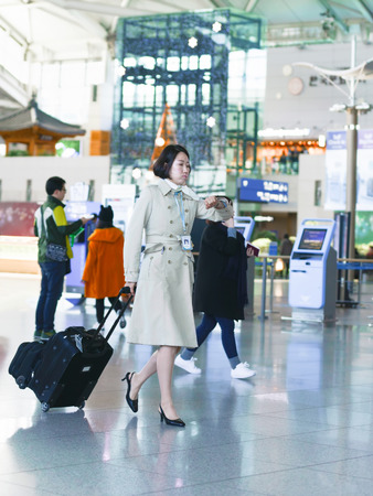 incheon: Incheon, South Korea - February 15, 2016: Asian Korean female flight attendant at International airport of Incheon. It is one of the largest and busiest world airports.