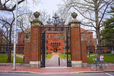 Entrance gate and East facade of Sever Hall at Harvard Yard in Harvard University in Cambridge, Massachusetts, MA, USA. It is used as the library, lecture hall and classroom for different courses.