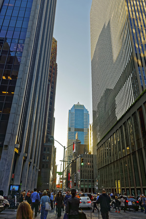the sixth: New York, USA - May 6, 2015: Intersection of Avenue of the Americas, or Sixth Avenue, and West 47th Street in Midtown Manhattan. Morgan Stanley Building on the background. Tourists in the street Editorial