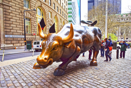 charging bull: New York, USA - April 24, 2015: Charging Bull at Wall Street in Financial District in Lower Manhattan, New York City, USA. Tourists in the street Editorial