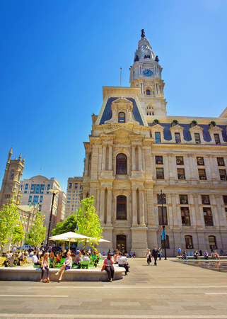 municipal court: Philadelphia, USA - May 4, 2015: Philadelphia City Hall with lots of tourists on Penn Square. Pennsylvania, USA.