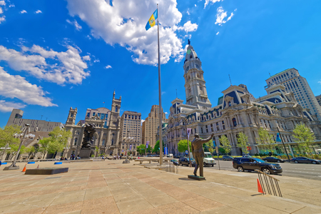 Philadelphia, USA - May 4, 2015: Square with sculptures and Philadelphia City Hall on the right. Pennsylvania, USA.