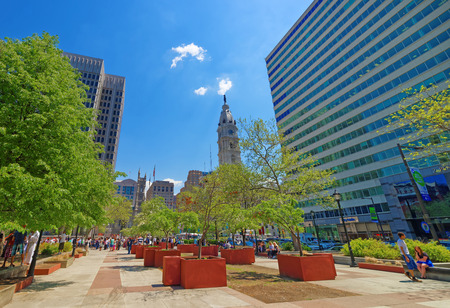 municipal court: Philadelphia, USA - May 4, 2015: Love Park with tourists and Philadelphia City Hall on background. Tourists in the park. Pennsylvania, USA.