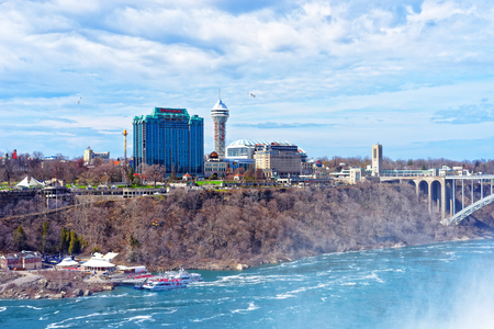 niagara river: Niagara Falls, USA - April 30, 2015: Rainbow Bridge across the Niagara River Gorge. It is an arch bridge between the United States of America and Canada