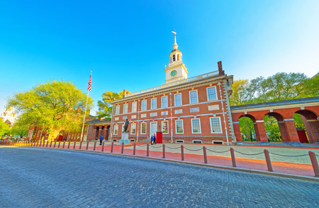 center hall colonial: Independence Hall of Philadelphia, Pennsylvania, USA. It is the place where the US Constitution and the US Declaration of Independence were adopted. Tourists in the street