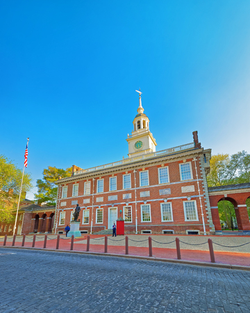 Independence Hall of Philadelphia, in Pennsylvania, USA. It is the place where the US Constitution and the US Declaration of Independence were adopted. Tourists in the street Editorial