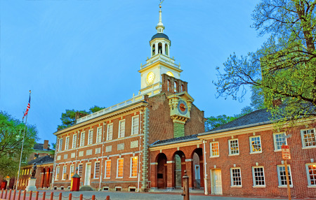 center hall colonial: Independence Hall in Chestnut Street in Philadelphia, Pennsylvania, USA in the evening. It is the place where the US Constitution and the US Declaration of Independence were adopted.