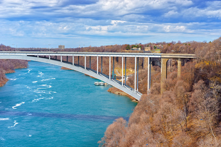 niagara river: International Rainbow Bridge above Niagara River Gorge from American side near Niagara Falls. It is an arch bridge between the United States of America and Canada. Stock Photo