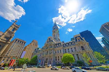 Philadelphia City Hall with William Penn figure on Tower. View from the street. Tourists in the street. Pennsylvania, USA
