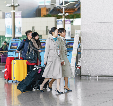 incheon: Incheon, South Korea - February 15, 2016: Two Asian Korean female air flight attendants at Incheon International airport. It is one of the largest and busiest world airports.