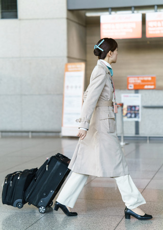 incheon: Incheon, South Korea - February 15, 2016: Asian Korean air flight stewardess in Incheon International airport. It is one of the largest and busiest world airports. Editorial
