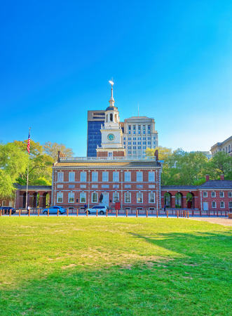 Independence Hall at Chestnut Street of Philadelphia, Pennsylvania, USA. It is the place where the US Constitution and the US Declaration of Independence were adopted. Tourist in the street